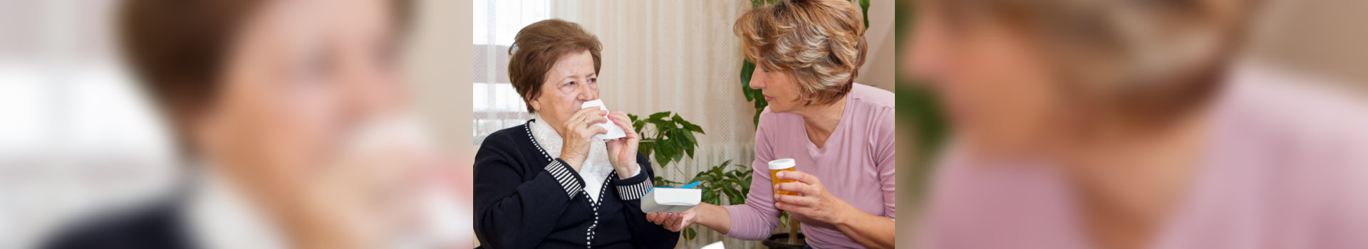 caregiver giving medication for her patient